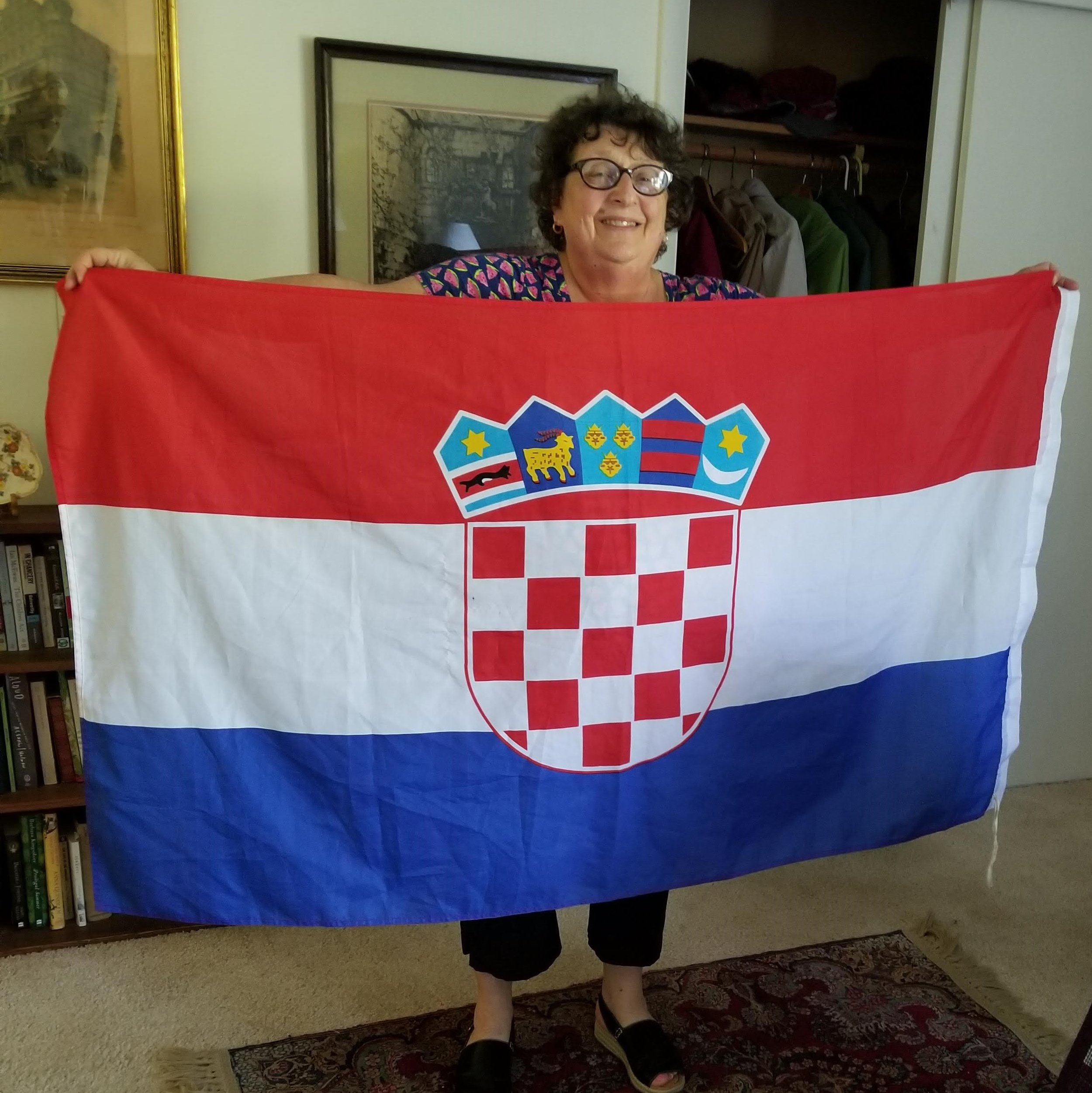 Kresha Warnock, pictured with a Croatian flag - celebrating after Croatia beat Russia in the World Cup