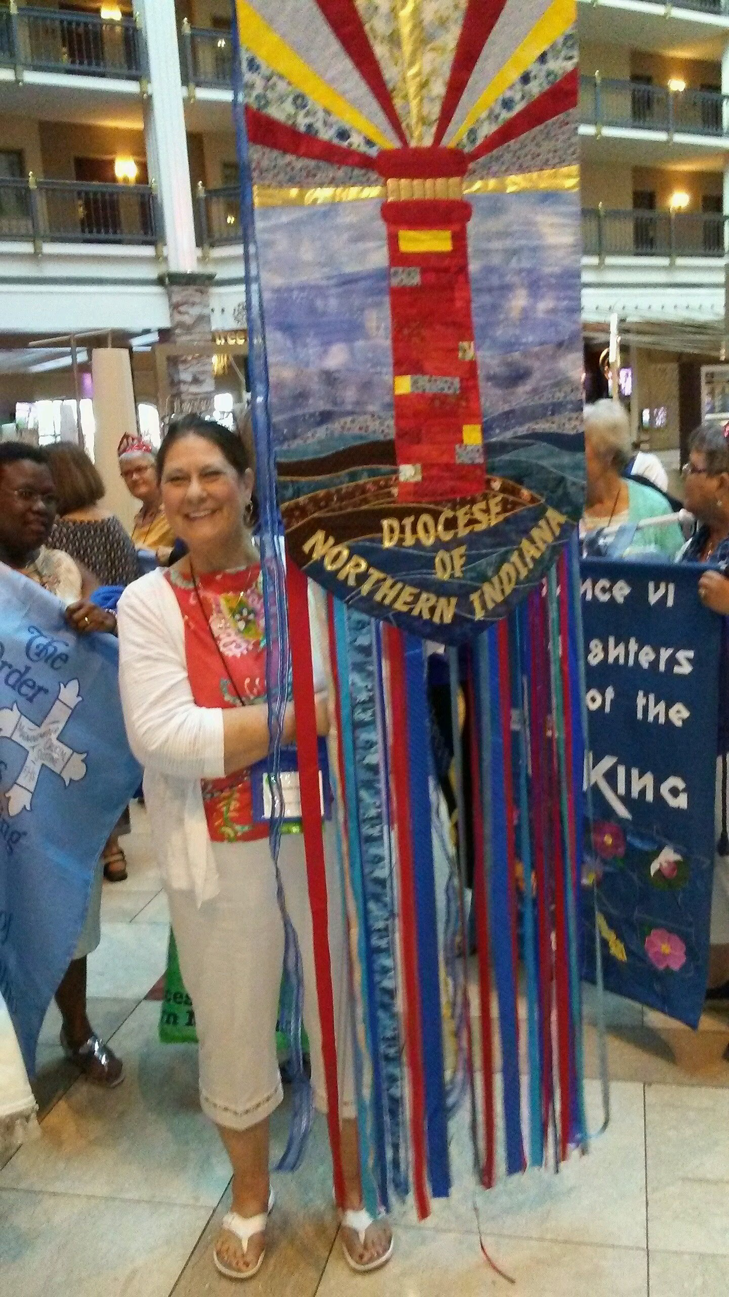 Celeste Hilliard, of the Cathedral of St. James, processing the Northern Indiana DOK banner during the Opening Eucharist of the DOK Triennial.