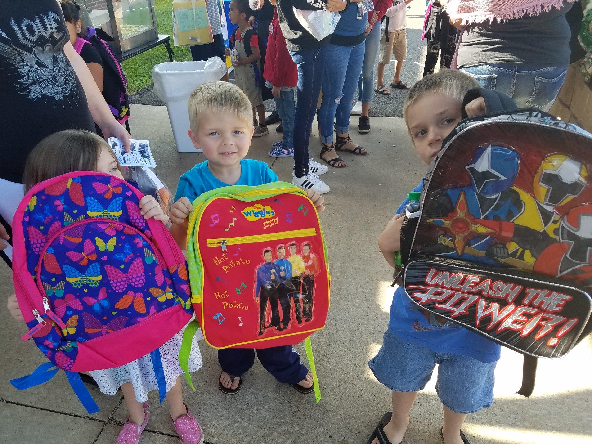 Happy backpack recipients