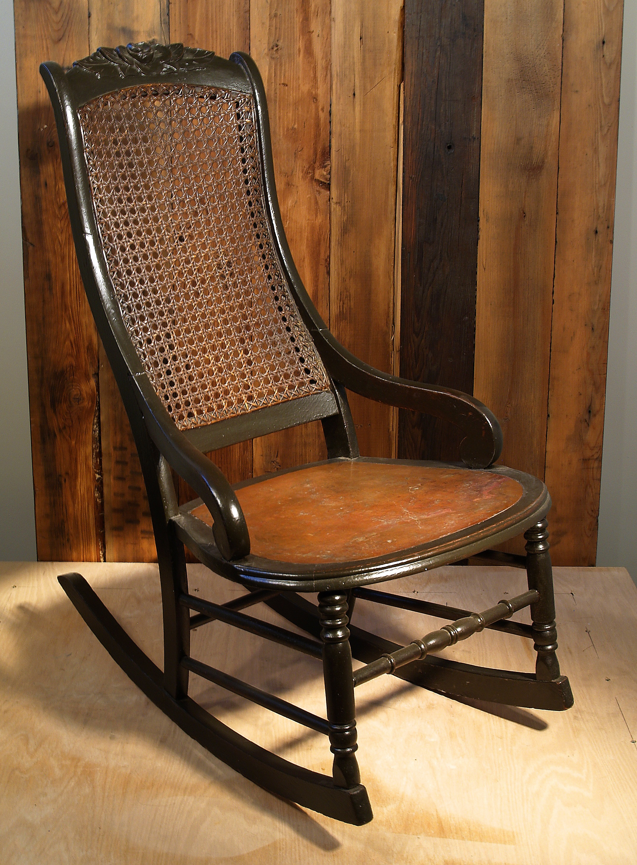 Antique rocker with copper seat plate.