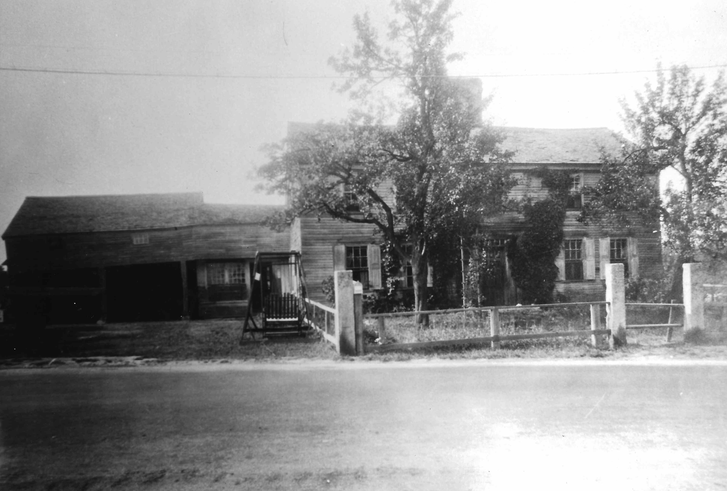 "The photograph from the Hopkinton Public Library, labeled ""Raftery Place -   Toll House Family Home E. Main near Clinton 1706. Moved to N. J. & reblt."""