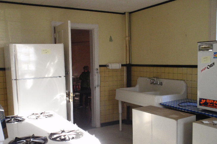 One of the rooms on the first floor of the ell was updated to a modern kitchen.