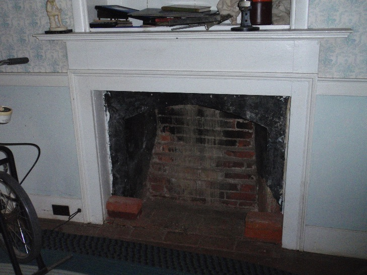 The Federal style fireplace in the east chamber
