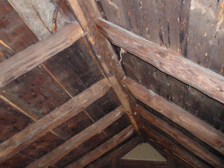 The framing in the attic, showing the rafters pegged into the five-sided ridgebeam