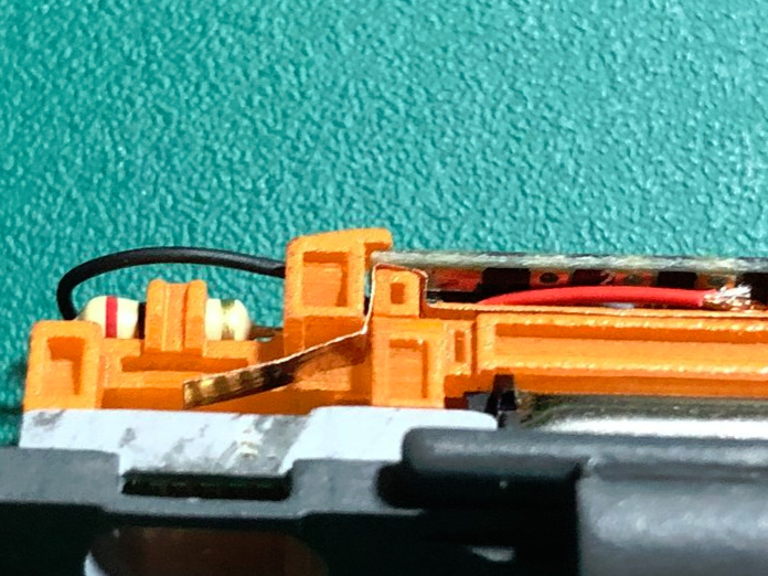 Check the fit - Make sure the PCB goes back as far as possible.If it does not reach all the way into the rear hooks, the PCB may need to be altered. See below.