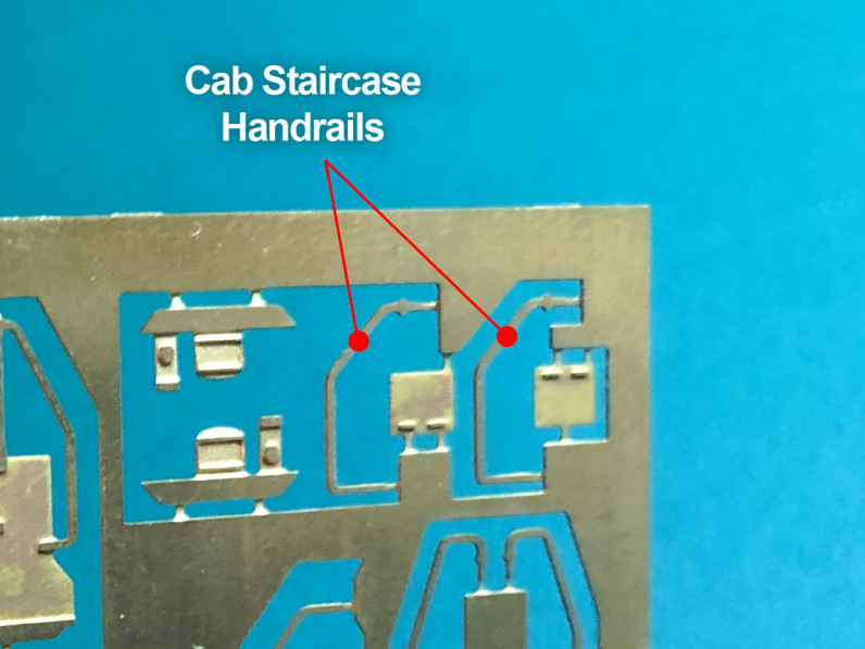 Step 7 - Cut the cab staircase handrails from the sprue.