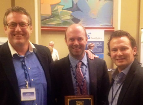 Stephen Tramontana (left) and Nick Weeks (right) of CHS with Doctor of the Year award recipient, Dr. Thomas Lally, at the 2014 AAHCM conference.
