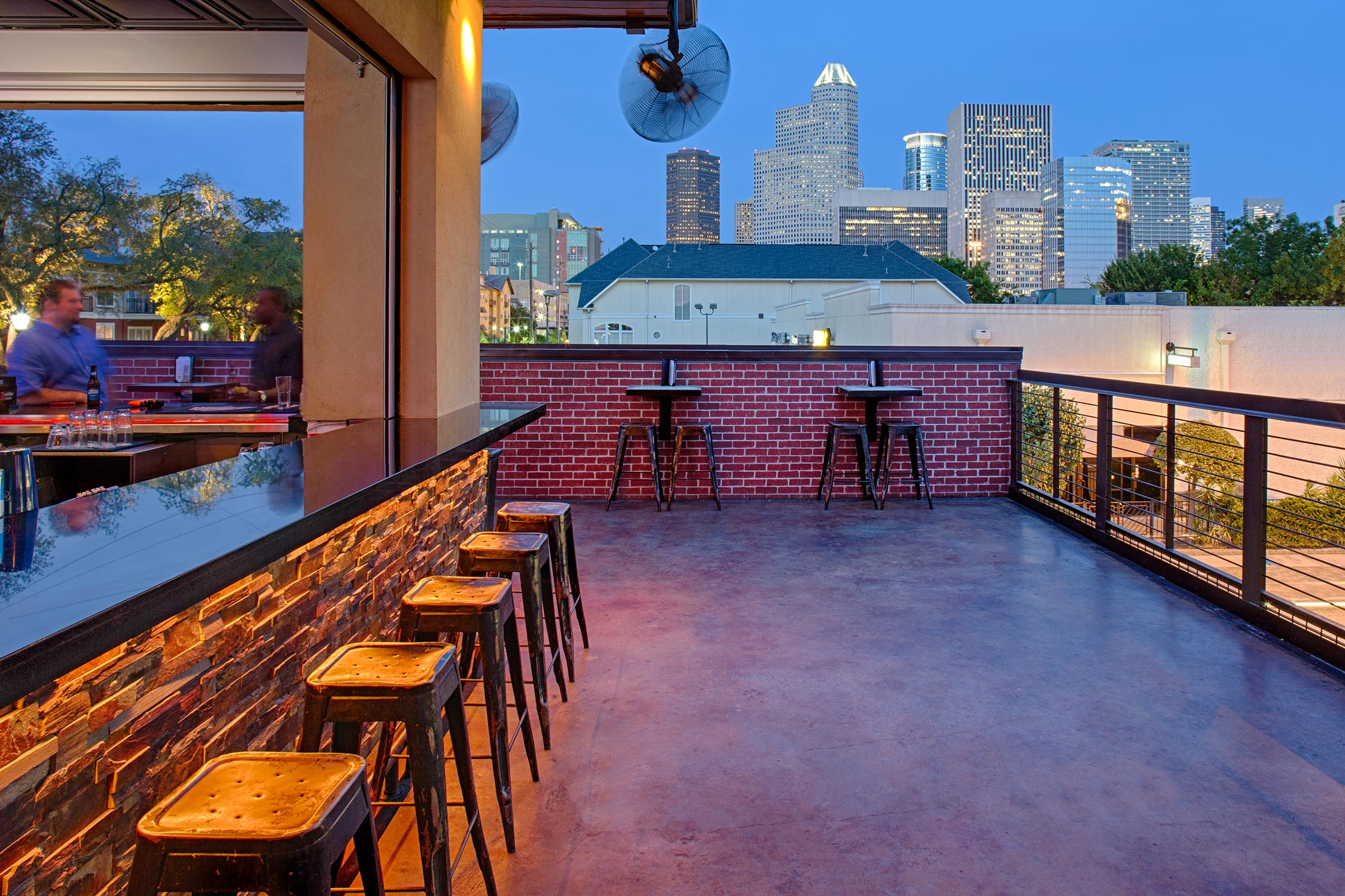 Quite often our barand restaurant designsfeature roof decks to get away from the heat and capture a view. (The Dogwood, Houston, TX)