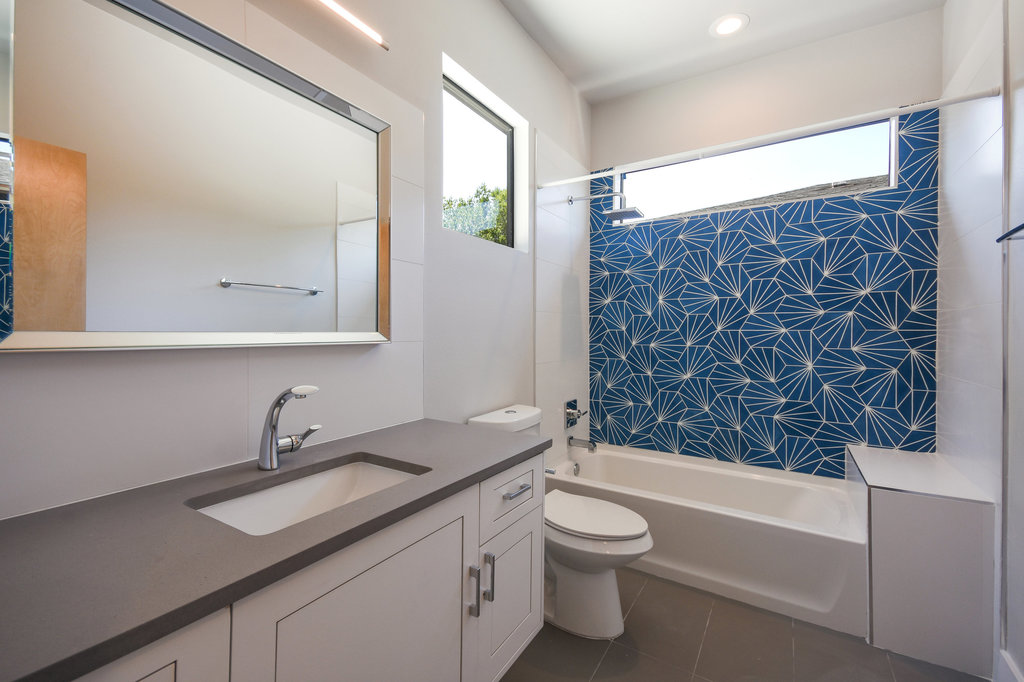 An otherwise plain bathroom can become interesting with the right use of tile.