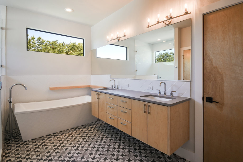 The floor tile on this bathroom would not be out of place on a 18th century bath house however it adds richness to this modern bath on our Peacock Residence.