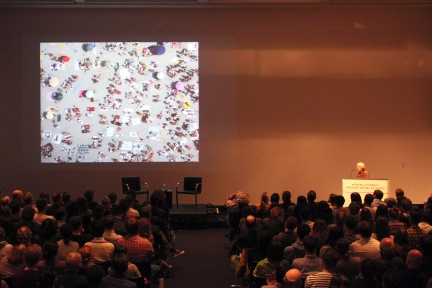 """Image Caption: Denise Scott Brown delivers """"Mayhew's Architecture"""" at the Harvard GraduateSchool of Design in 2013. In a note to Scott Brown, Italian architect Carolina Vaccaro wrote thatthe Petition is """"the worldwide acknowledgment that your outsider ideas and research are still (andwill be for a long time) the best source any architect can have!"""" Image Credit: Beth Roloff"""