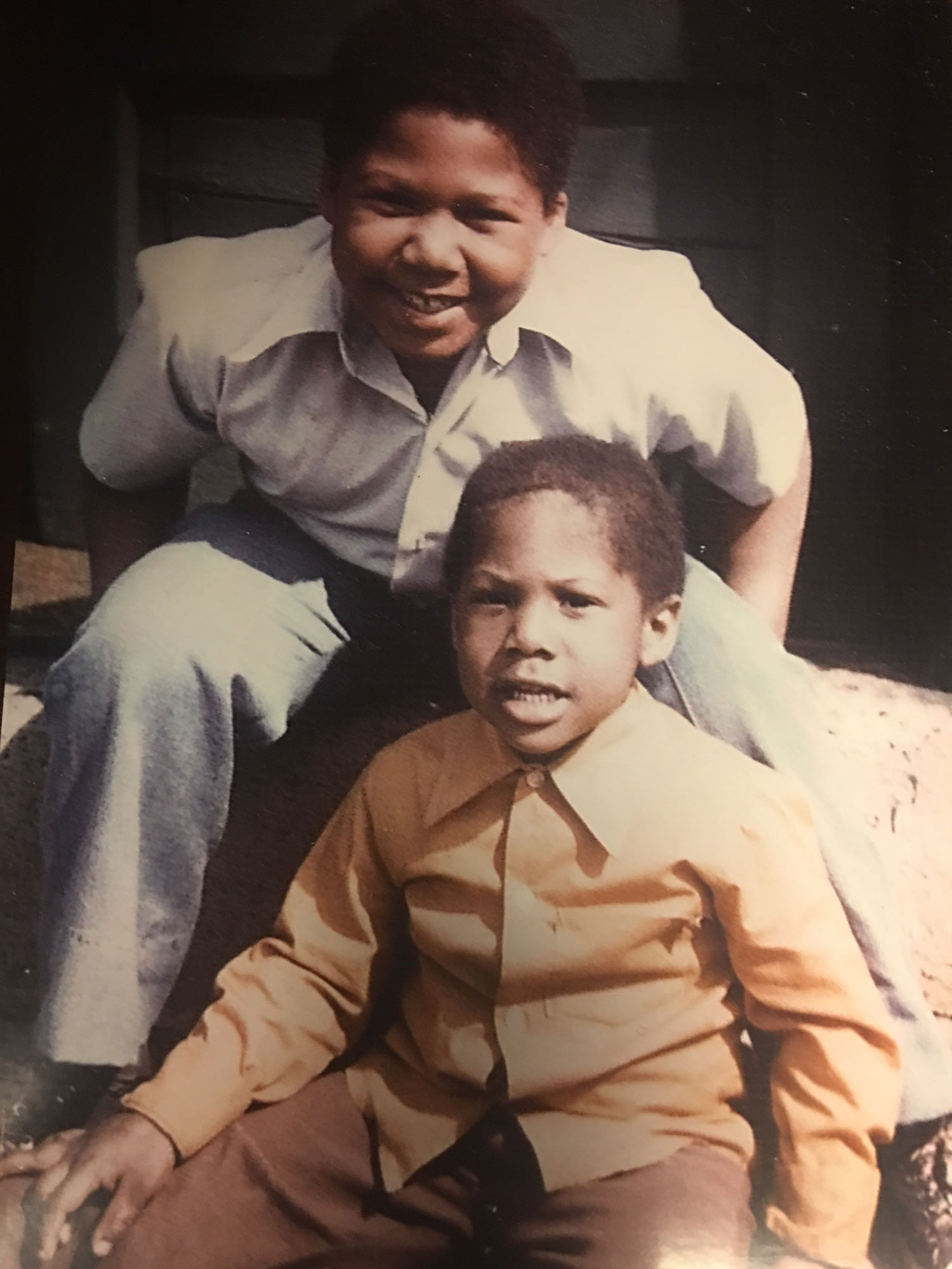 Michael, bottom, with his brother.