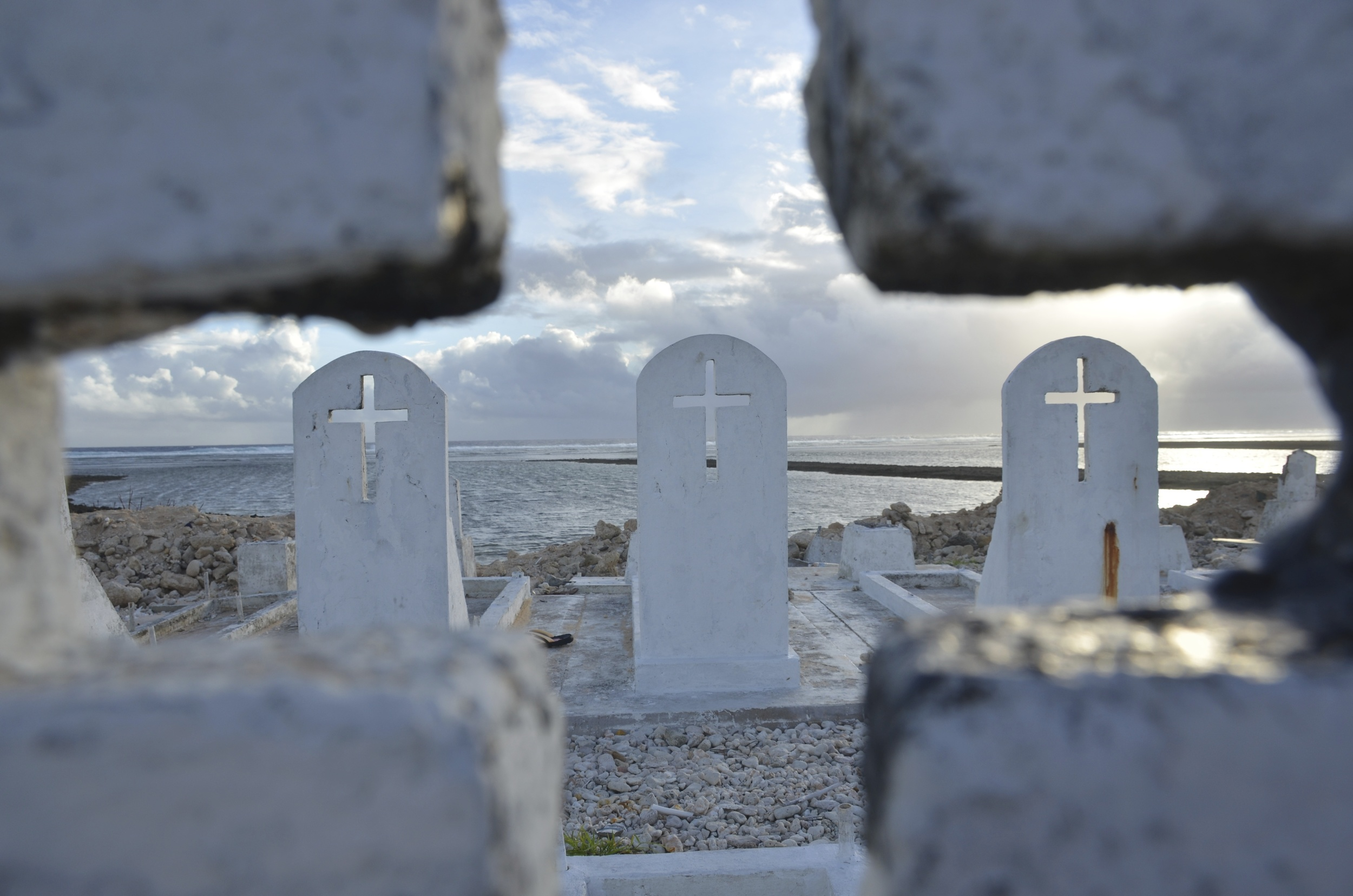 Tides strengthened by sea-level rise are clawing away homes and cemeteries.