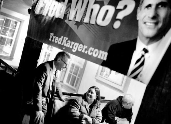 Karger, left, who has never held elective office, campaigns at a town hall gathering sponsored by the Monadnock Live Free & Equal Coalition at a Margaritas restaurant in Keene, N.H.  Photo by Matt Cavanaugh for The Washington Post