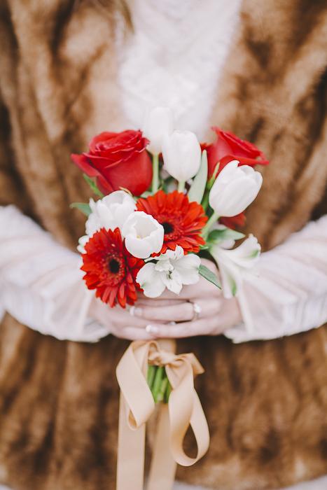 Woman holds a red and white bouquet - Sahara Coleman - Professional Wedding Photographer, Destination Photographer 2014 Seattle Washington