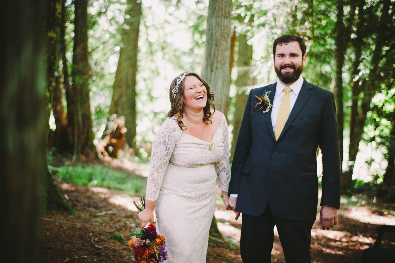 A bride and groom try to maintain a straight face in their wedding photograph
