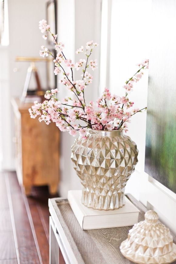 These pink flowering branches of a cherry tree work perfectly with the geometric silver vase.