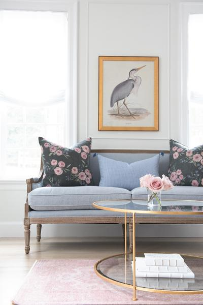Caitlyn Wilson's addition of pillows adds color to the space;romantic with just the right touch of femininity.