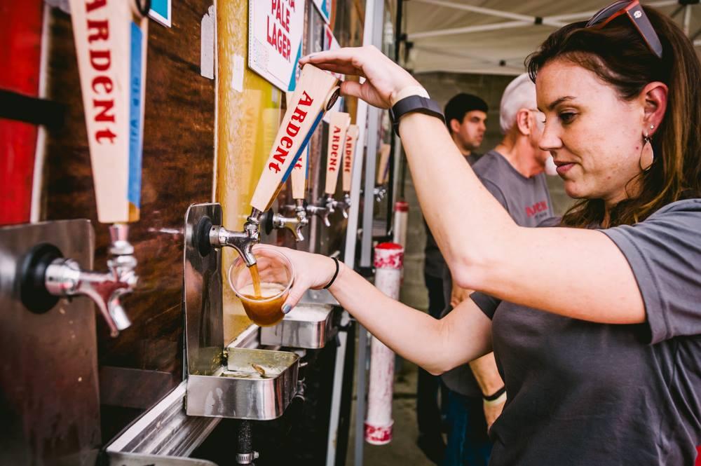 volunteer pouring beer.jpg