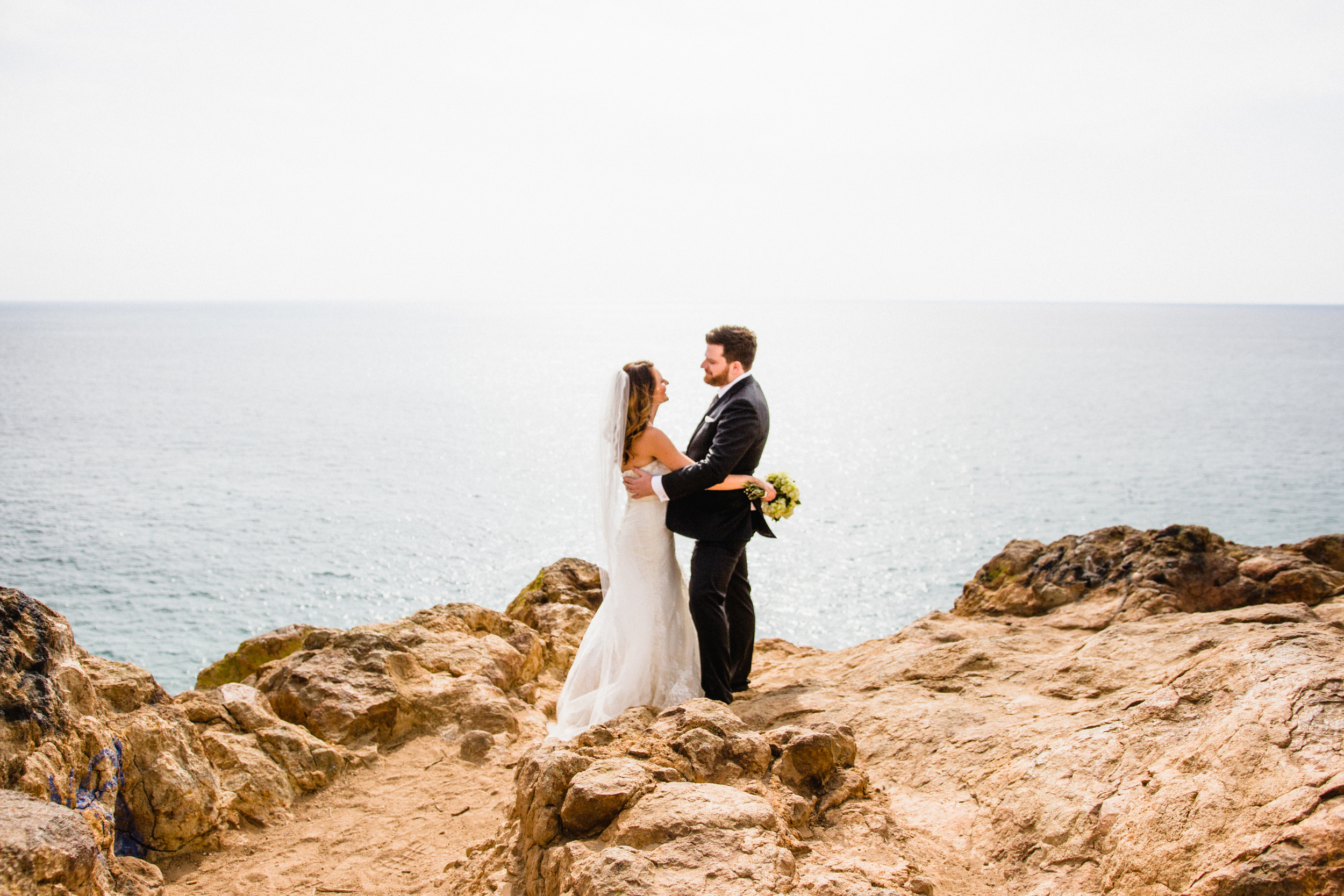 Wedding photography. DIY wedding at Point Dume Malibu. Bride and groom stare into each other's eyes overlooking the ocean