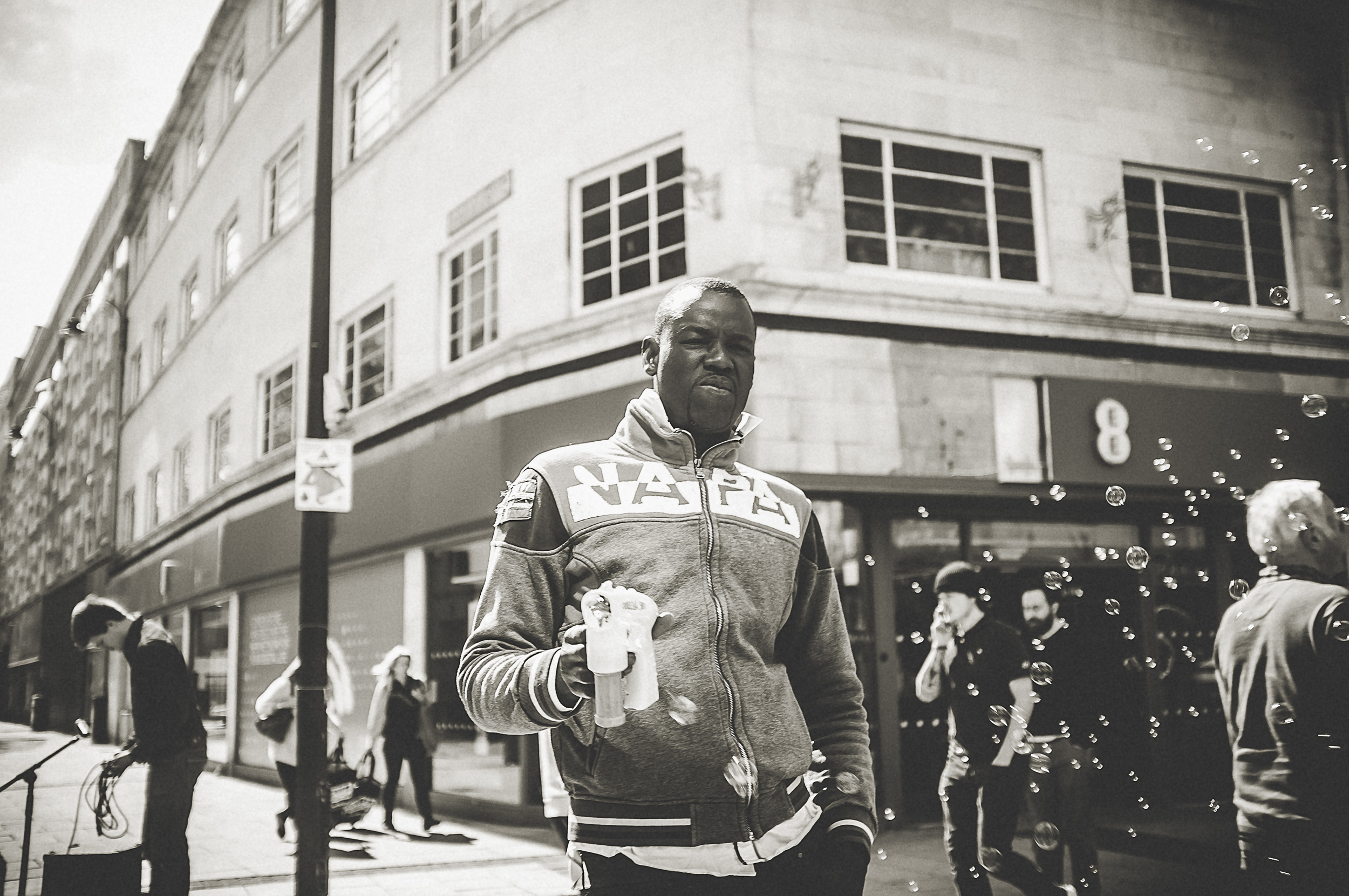 Street photography with the fuji X100 - Shooting from the hip.