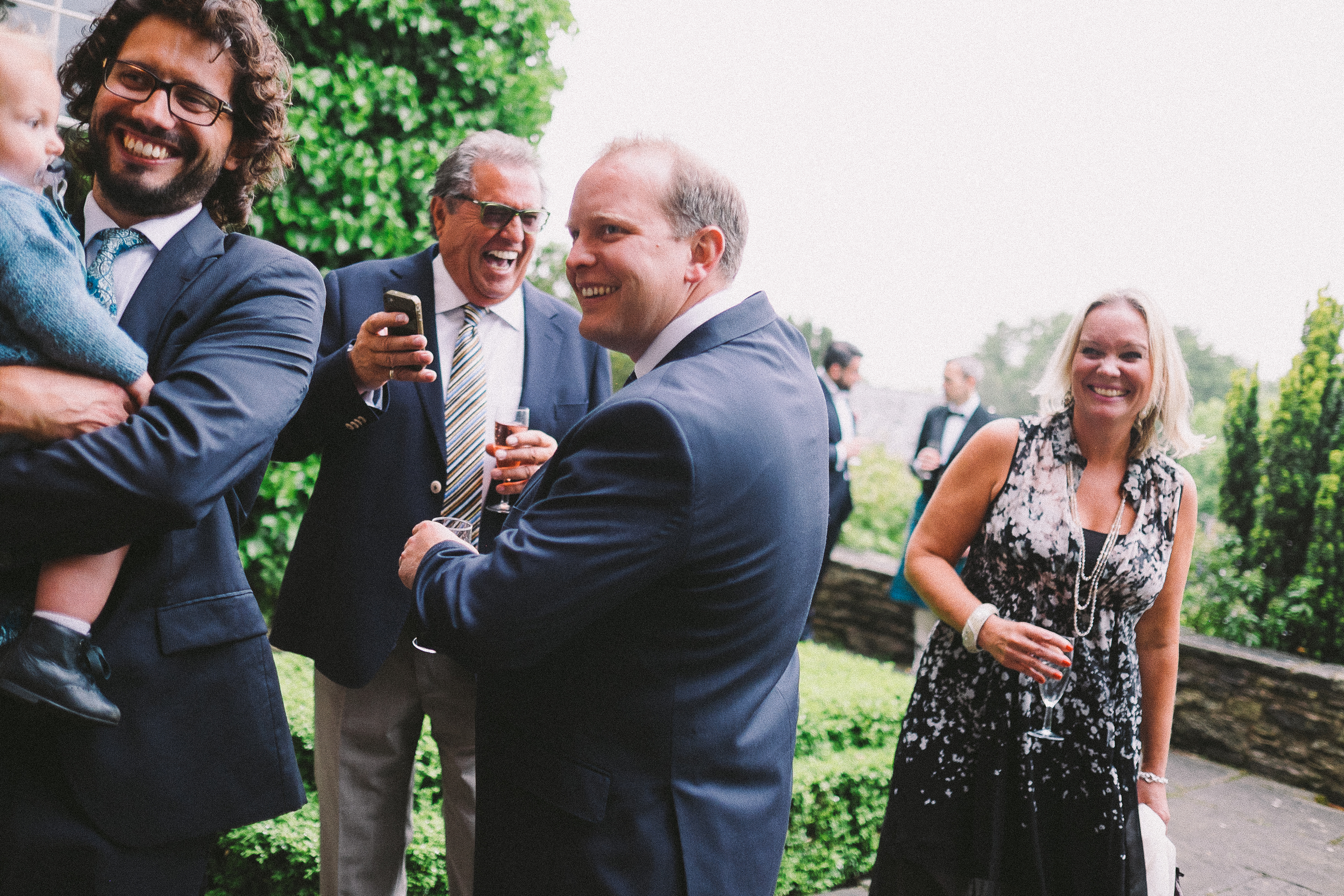 This is what documentary wedding photography is all about, getting shots without people knowing. This image was shot from the hip without looking, in the time it would of taken and with the attention I would of drawn, for me to lift the camera up to my eye this shot would have been missed.
