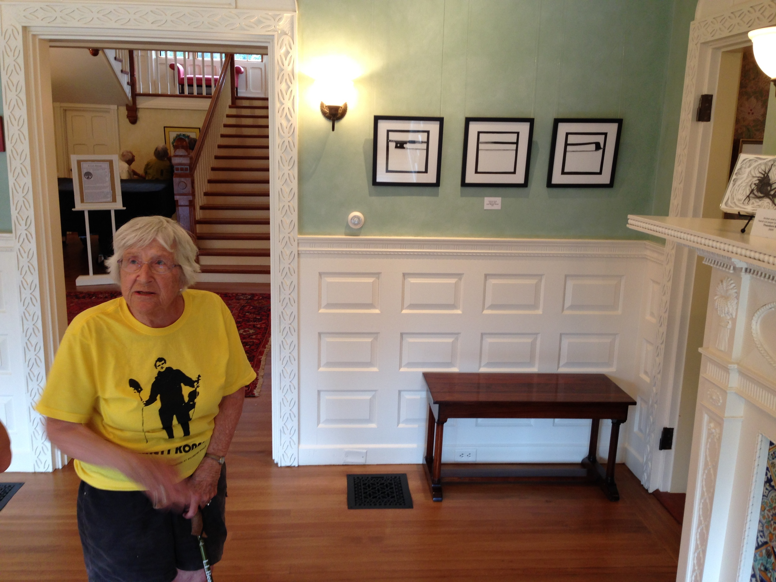 Here's my fiddle bow triptych on display at the American Guild of Papercutter's annual show... at Highfield Hall in Falmouth, Massachussets. That's my grandmother Leila Fiske Ostby, looking on.