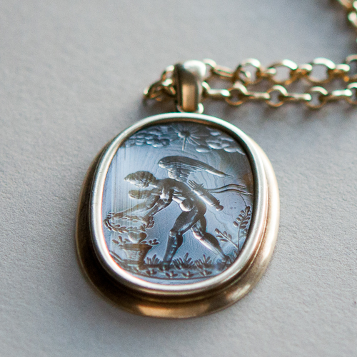 An antique agate intaglio pendant (circa 1600) depicts Eros as a muscular, winged youth. Courtesy: Elaine Souza, Gladstone Jewelry