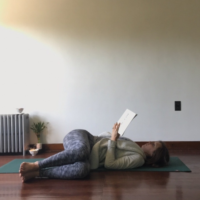 6.) Supine Twist - This is another one that's ideal for a paperback. Lie down and roll the knees to one side. Feel free to add support under or between the knees and visit both sides.