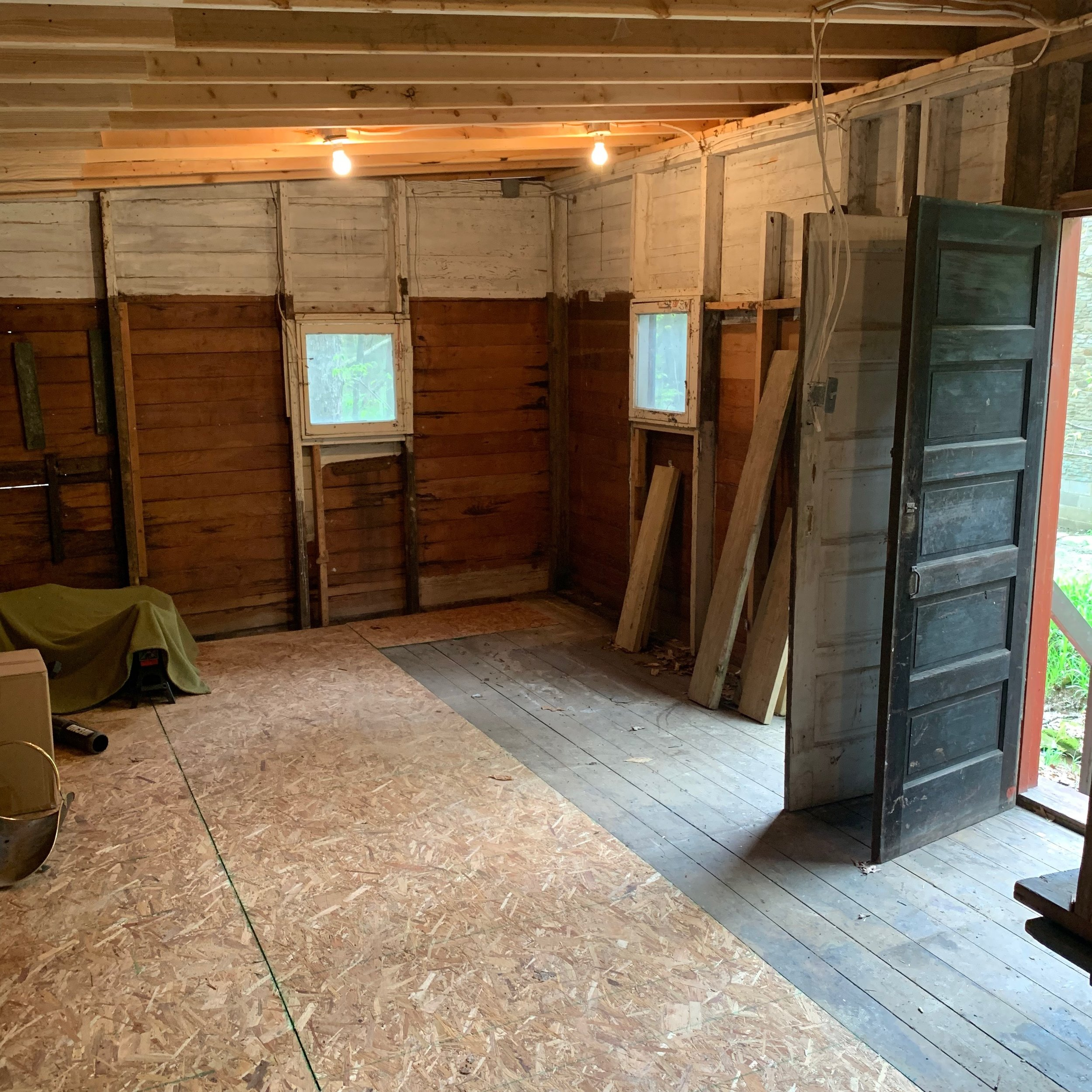 We got the floor repaired and leveled in late April! We will be using this as temporary storage while we continue renovations in the cabin/build a shed.