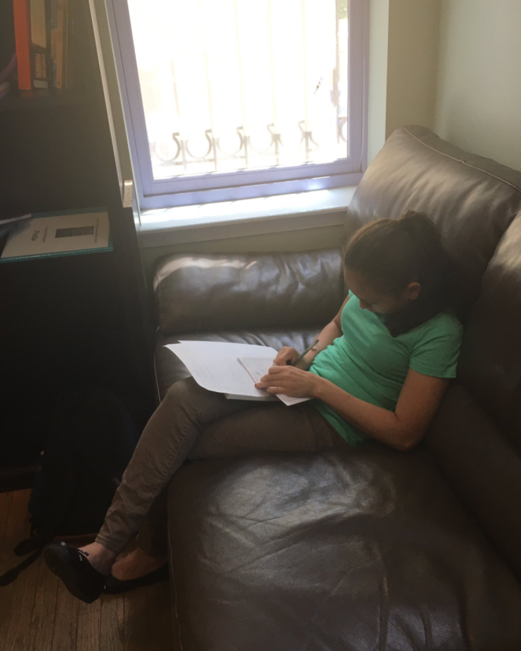 Amaya from El Salvador works on her story.