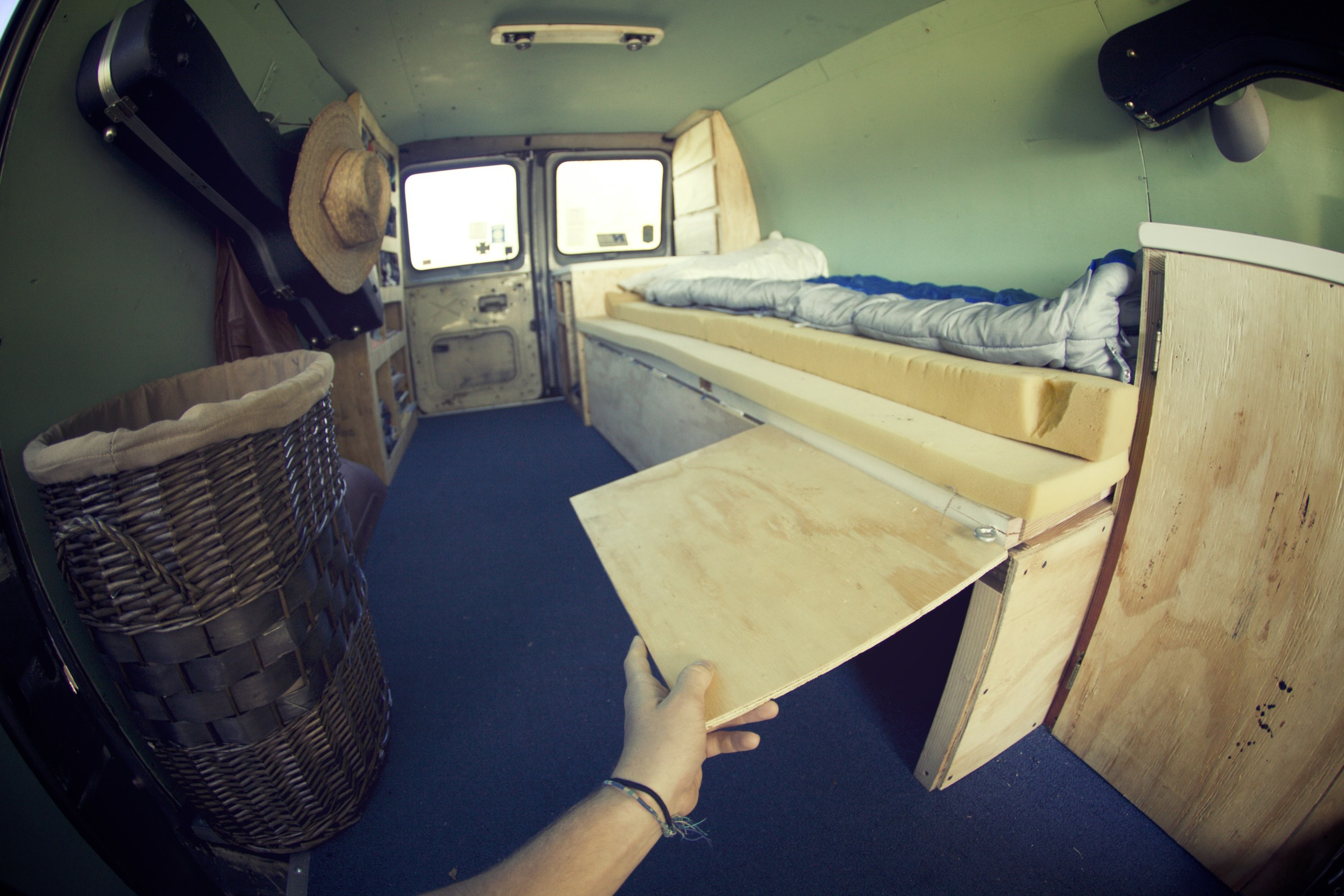 There are three boxes that slide out from under the bed. We built three little doors to access them.
