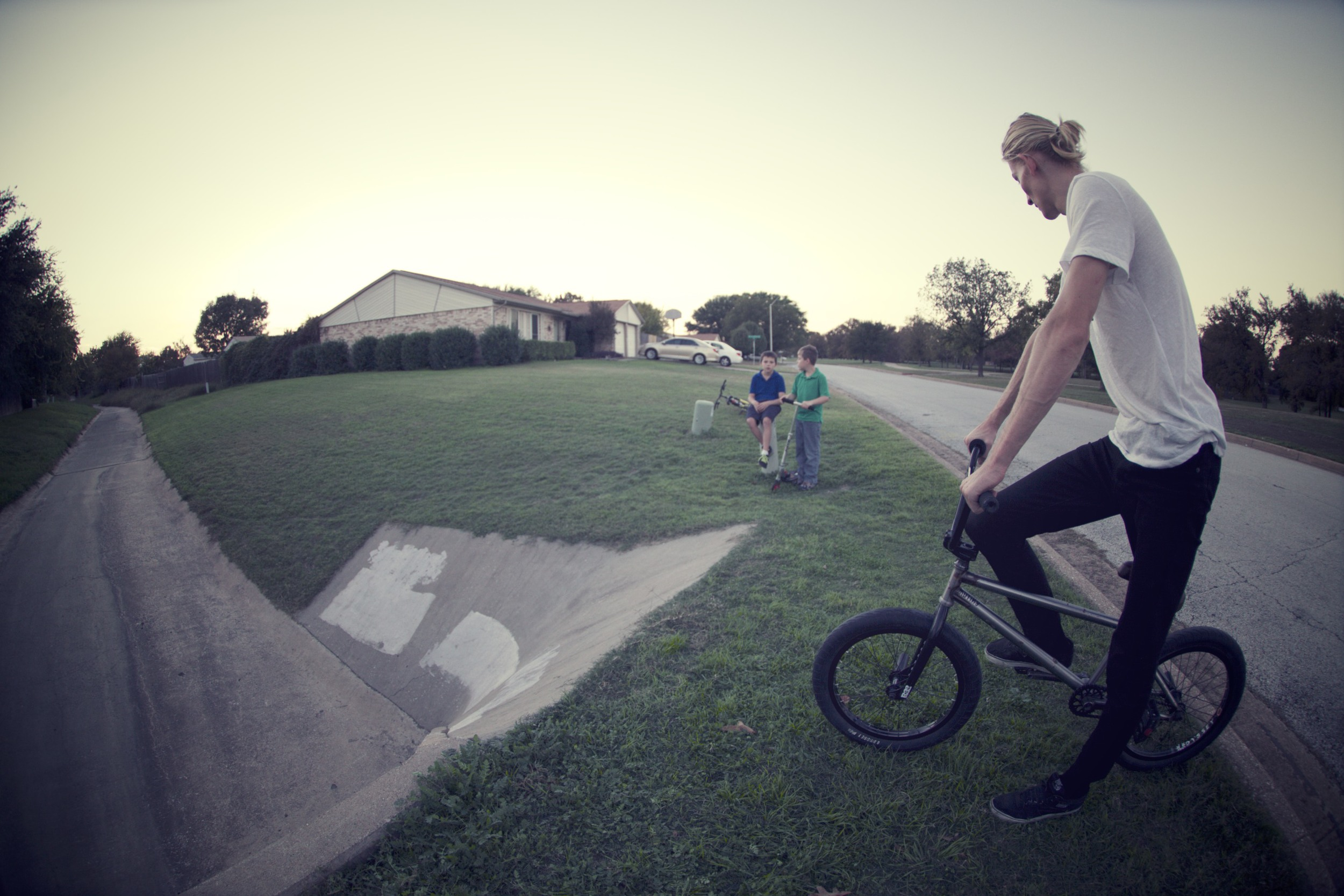 Talking to a couple of kids who ride the same spot he rode at the same age. Sweet.