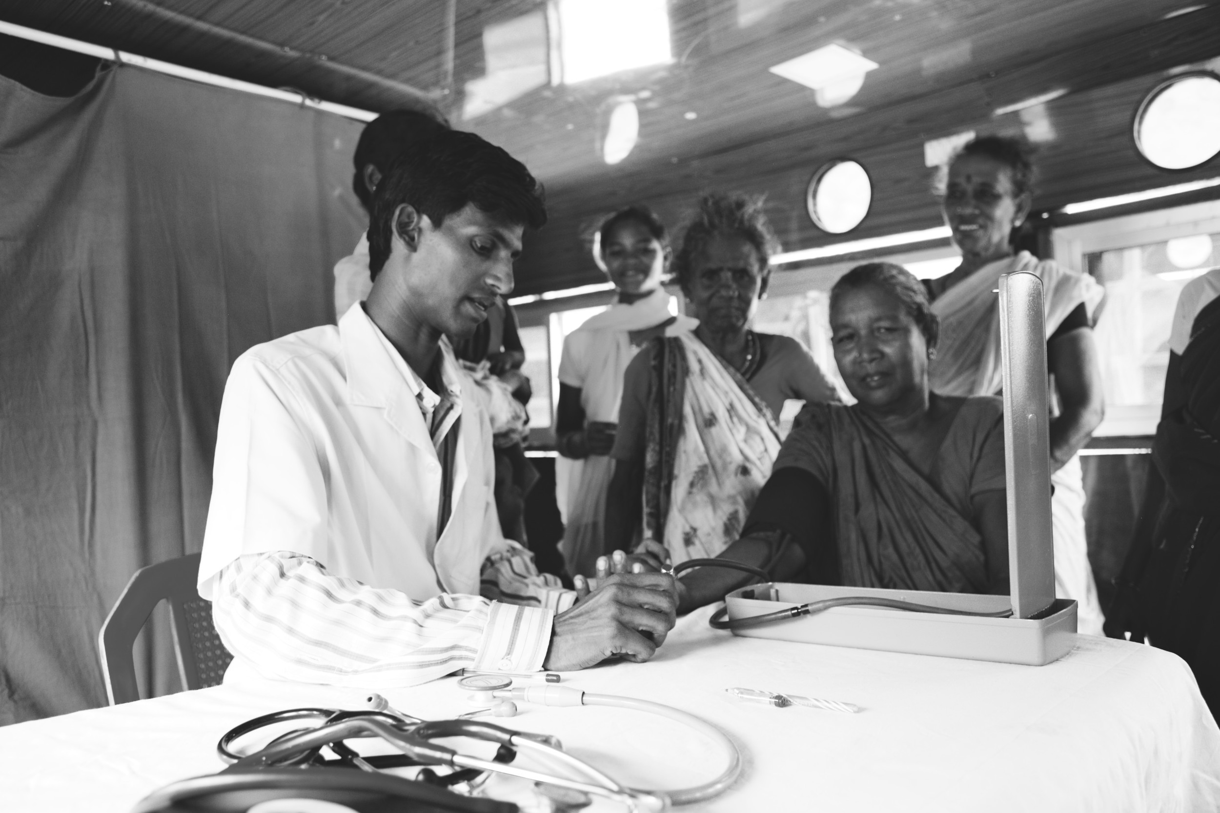 A young doctor helping patients on the medical boat we took to remote villages.