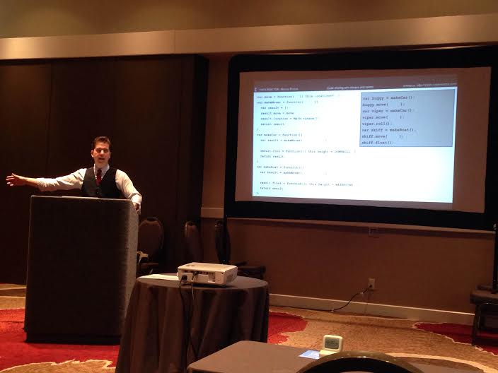Marcus Phillips presents a focused, interactive lesson at JS Conf. PHOTO: Kwyn Meagher, @HarleyKwyn