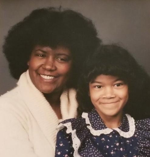 Sheena as a child, alongside her mother