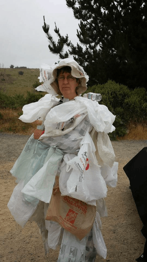 Sita from All One Ocean collects trash on Limantour Beach