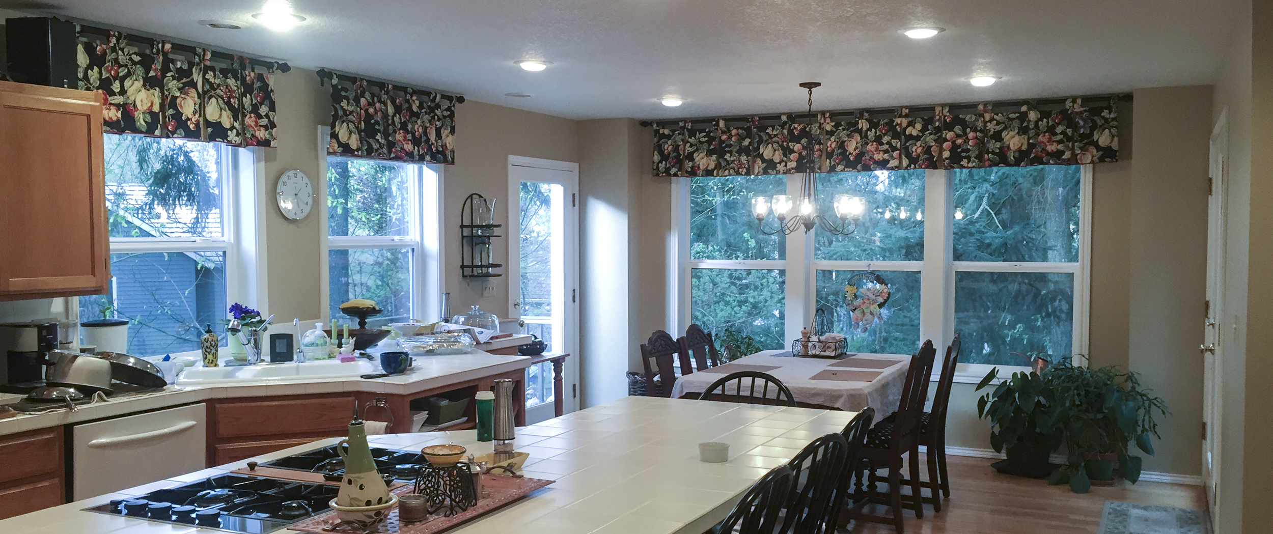 The final color, Macadamia, tied in with the curtains, wood cabinets and floors to provide a warming neutral to the room.