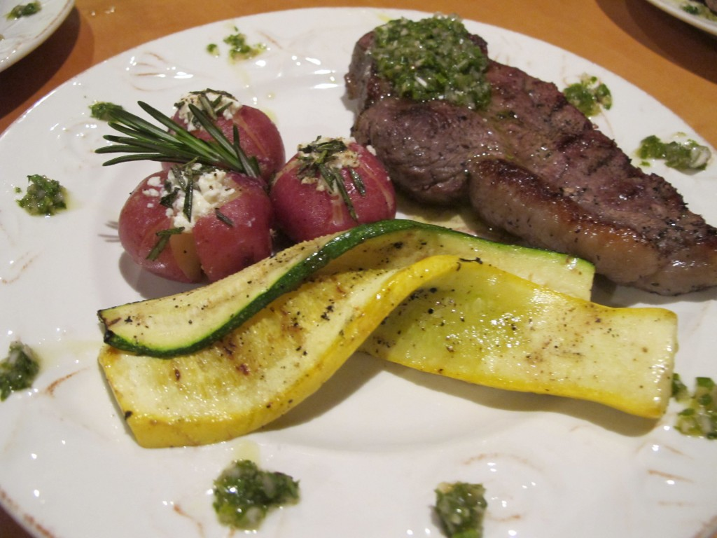 Grilled Rib Eye Steak with Chimichurri Sauce, Twice Baked Rosemary Potatoes, Grilled Yellow and Zuchini Squash.  Green Flash Entree
