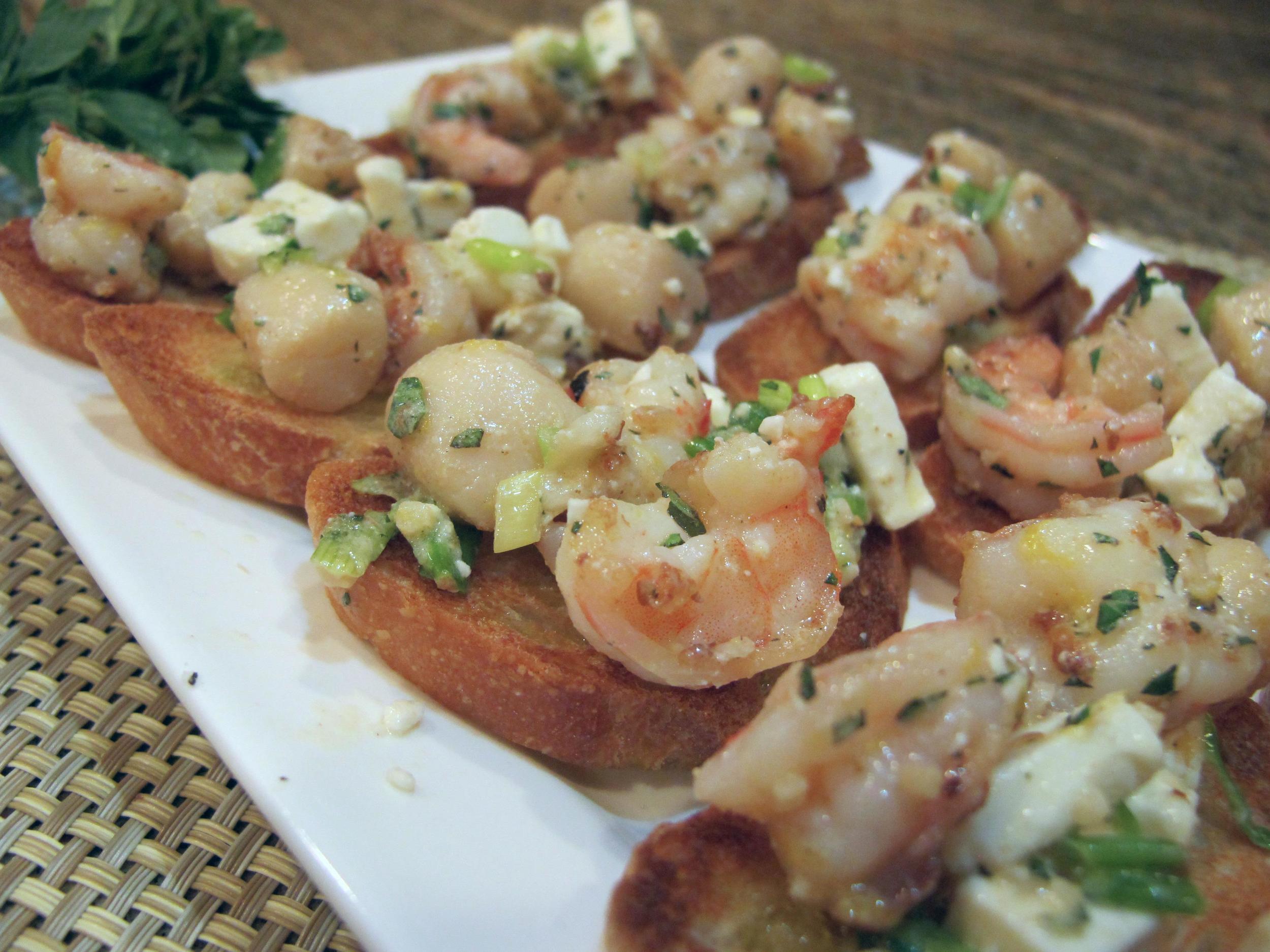 Shrimp and Scallops with Feta, Fresh Oregano and Lemon over Crostinis