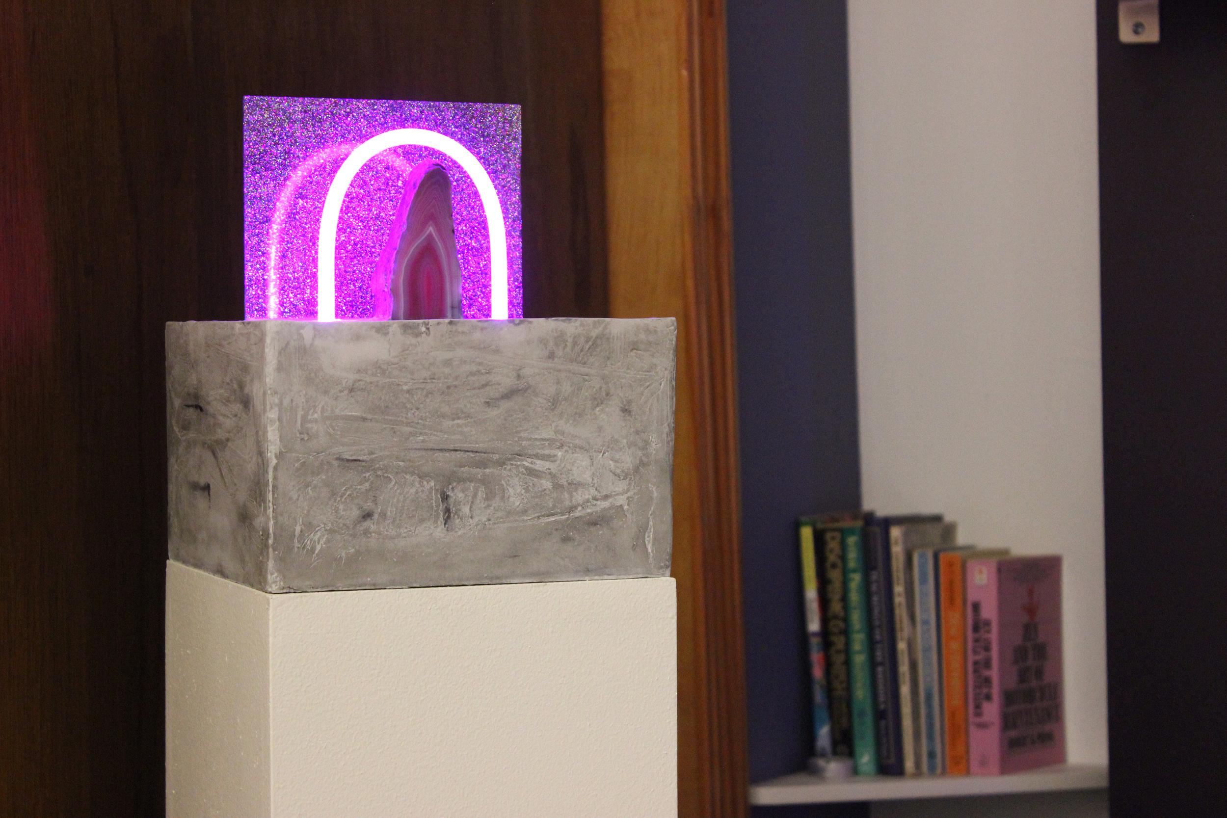 Ester Ruiz, Quintessence, the Fifth Essence , 2015, Hydraulic cement, glittered plexiglas, neon, Brazilian agate