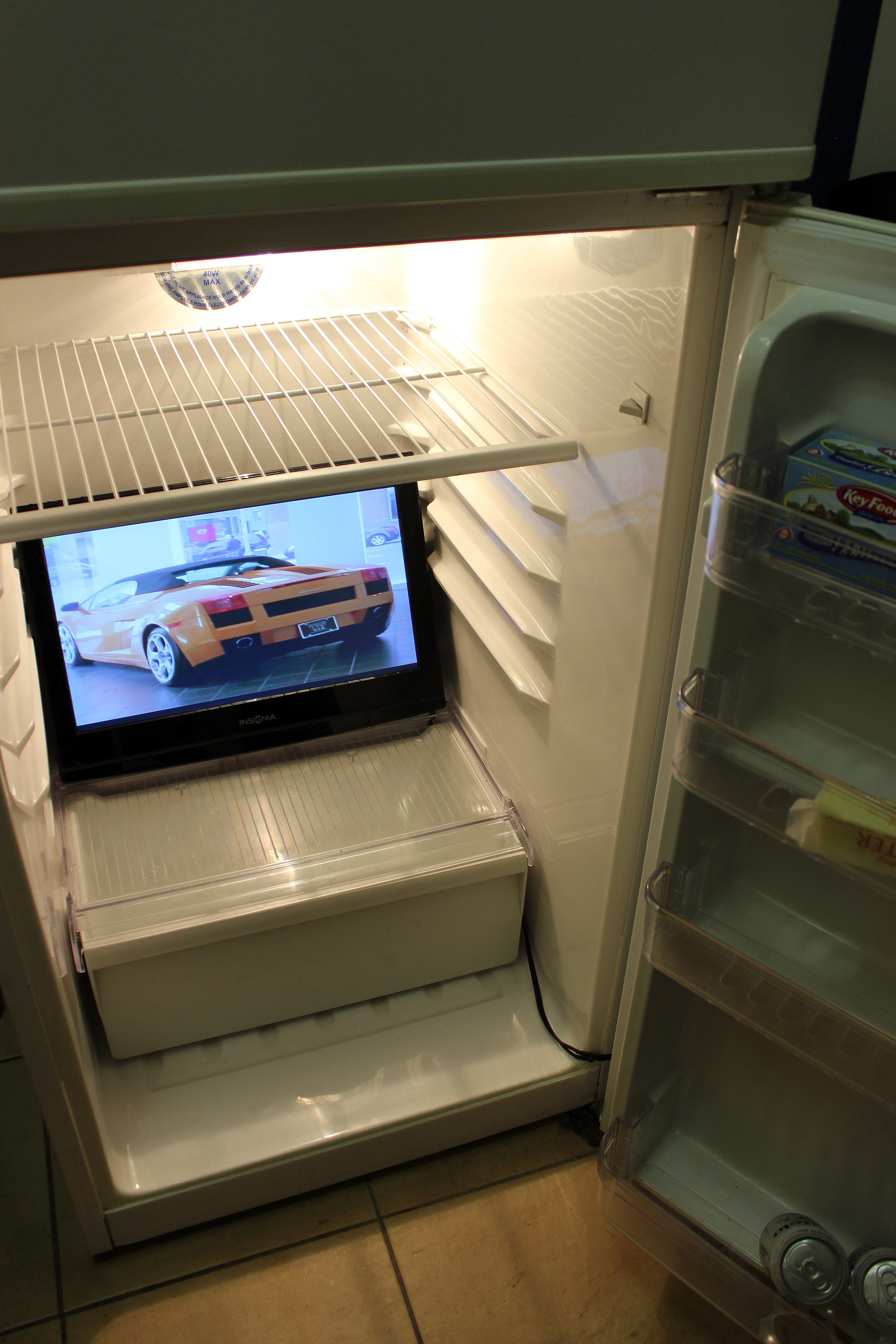 Ben Dowell,  2008 Lamborghini Gallardo (One Mind) , 2008, dvd, monitor, refrigerator, dimensions variable