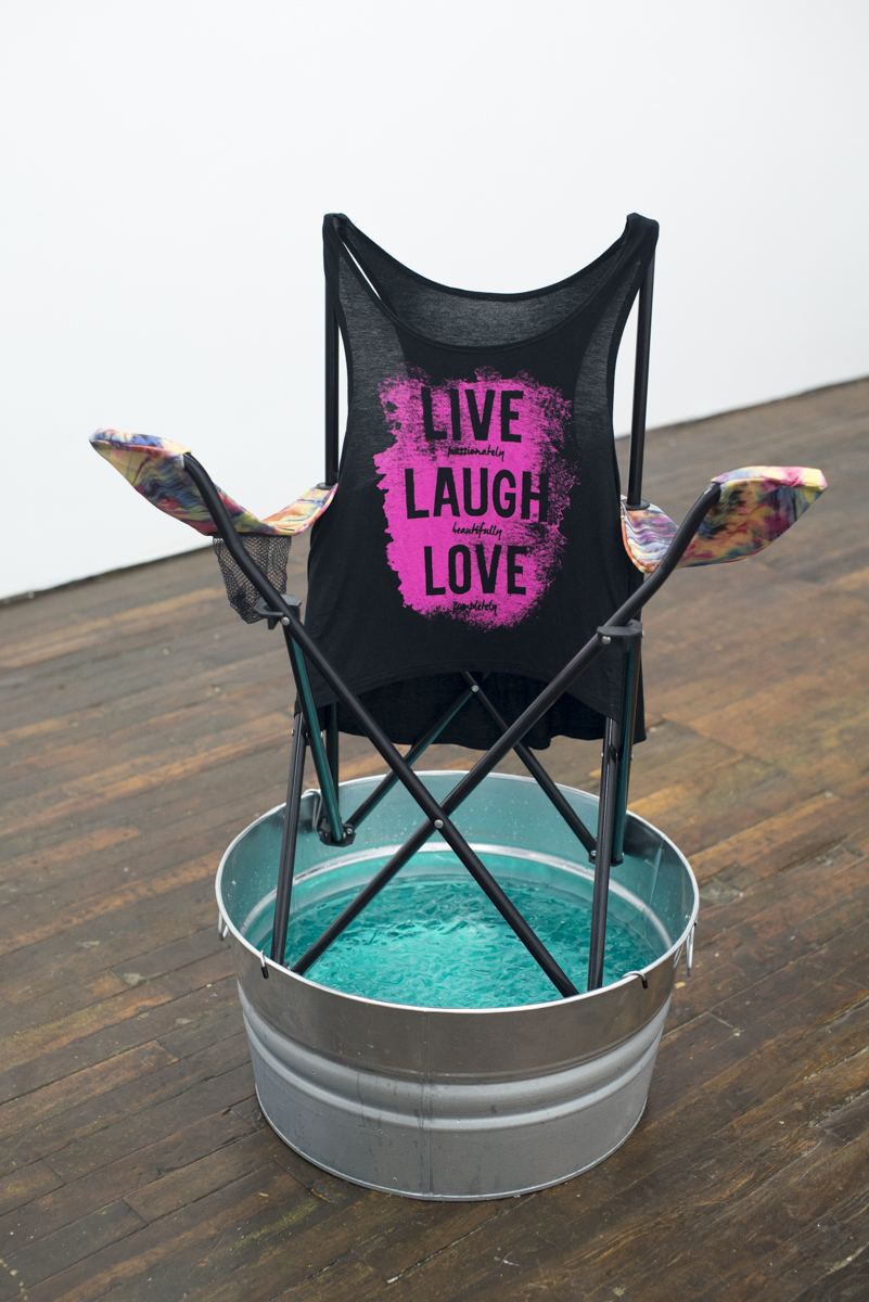 "Live Laugh Love , 2015, folding chair, printed spandex, metal bucket, hooks, ice, water, food coloring, 40"" x 22"" x 22"""