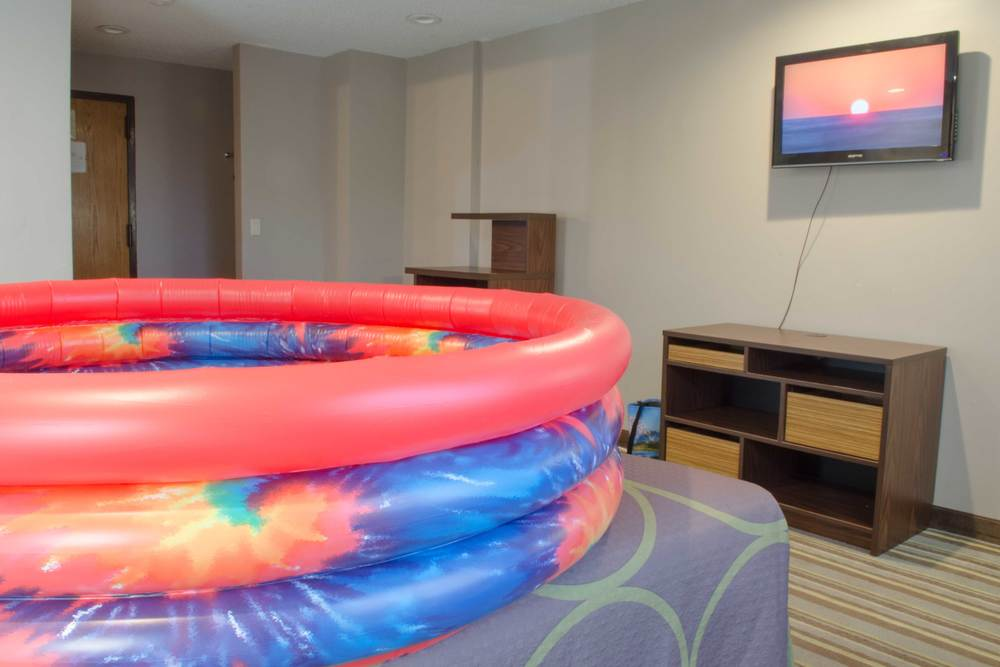 "Vibrating Waterbed , 2015, inflatable pool, water, personal massager, 65"" x 65"" x 14.5""   I'm Goin' Down , 2015, single channel video, 1 min 50 sec"