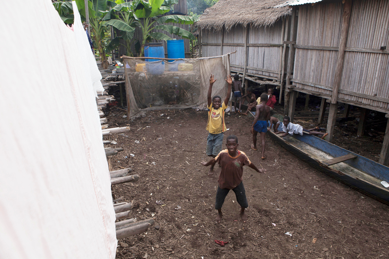 These kids were on a section of land playing soccer as best as they could within the cramped space. On the left is laundry hanging on a line. Overall the children were very curious and friendly.