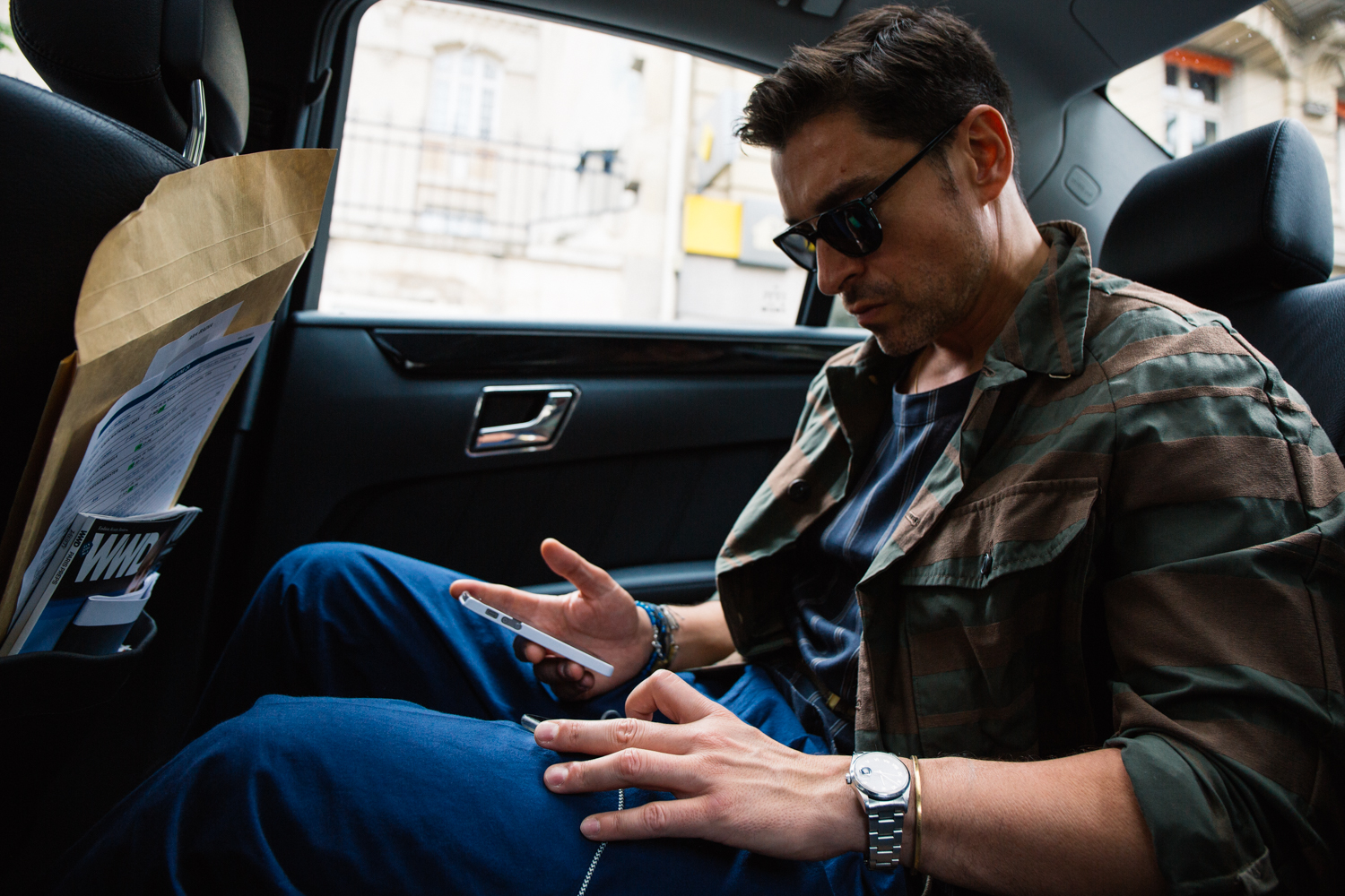 Working out of his phone in between shows is a norm for this busy fashion director.