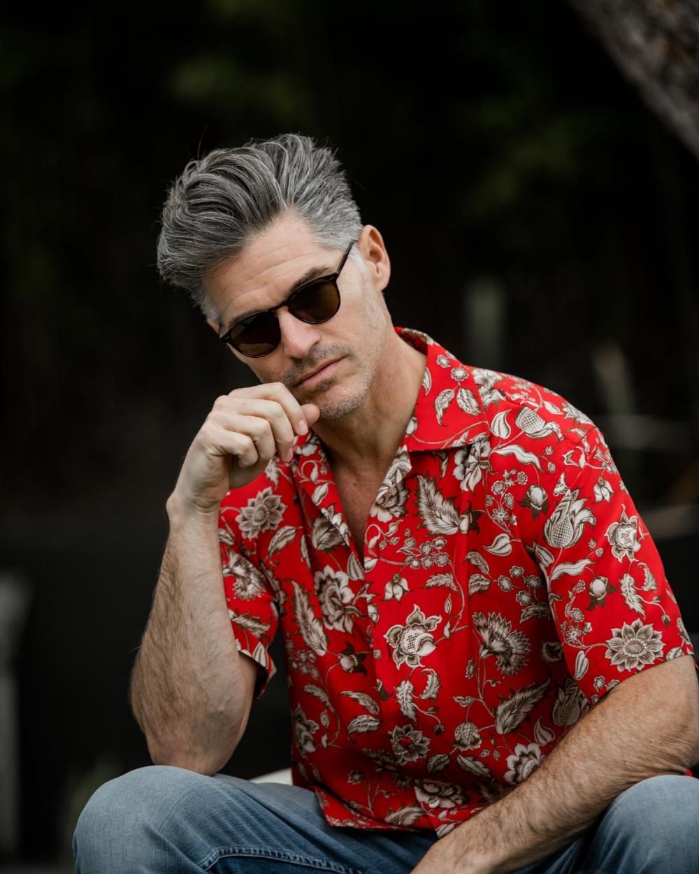 Gucci shirt; Sandro denim pants