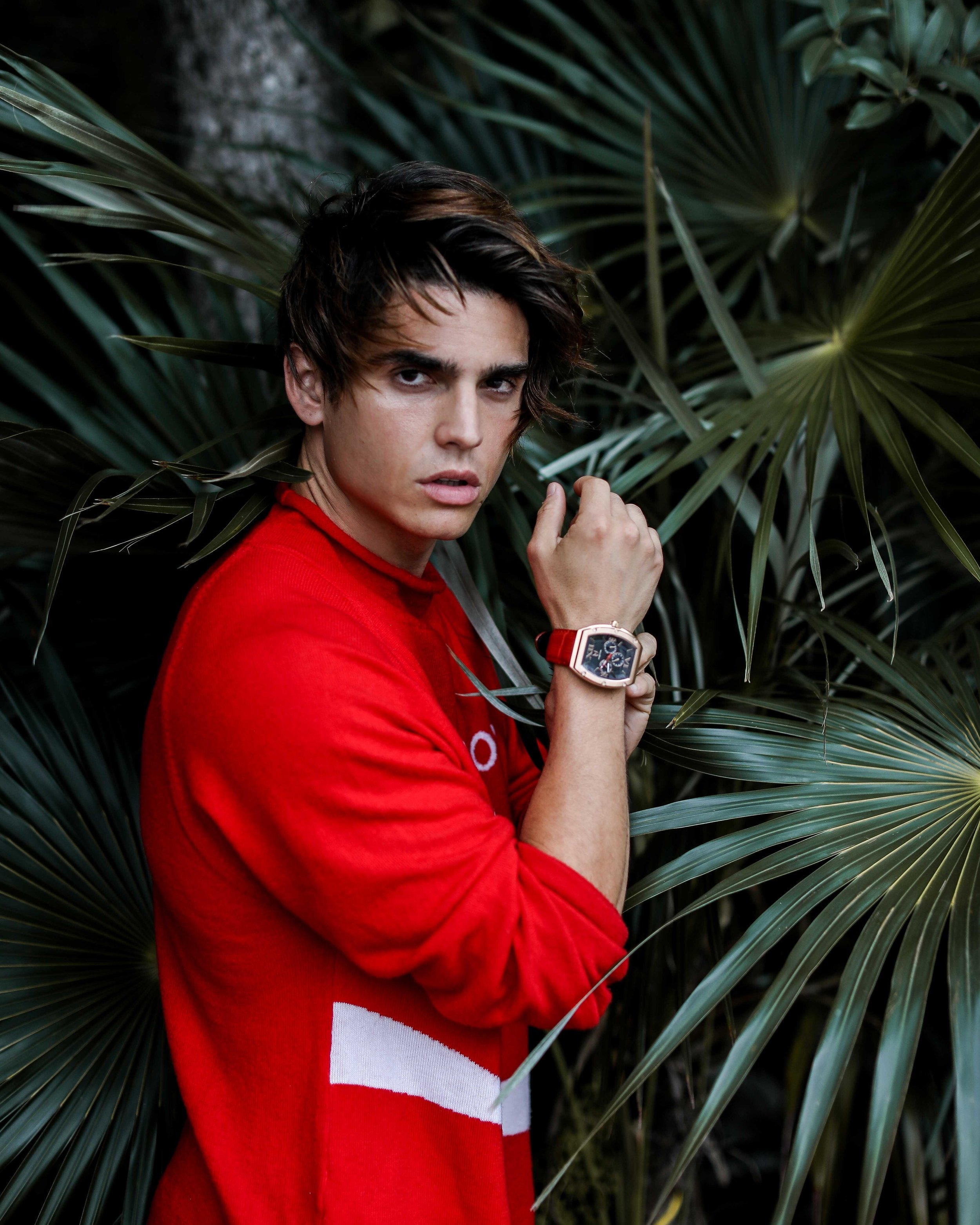 Troy Pes giving us tropical chicness sporting the red limited edition  Major from MSTR Watches  and a top from Jeremy Scott.
