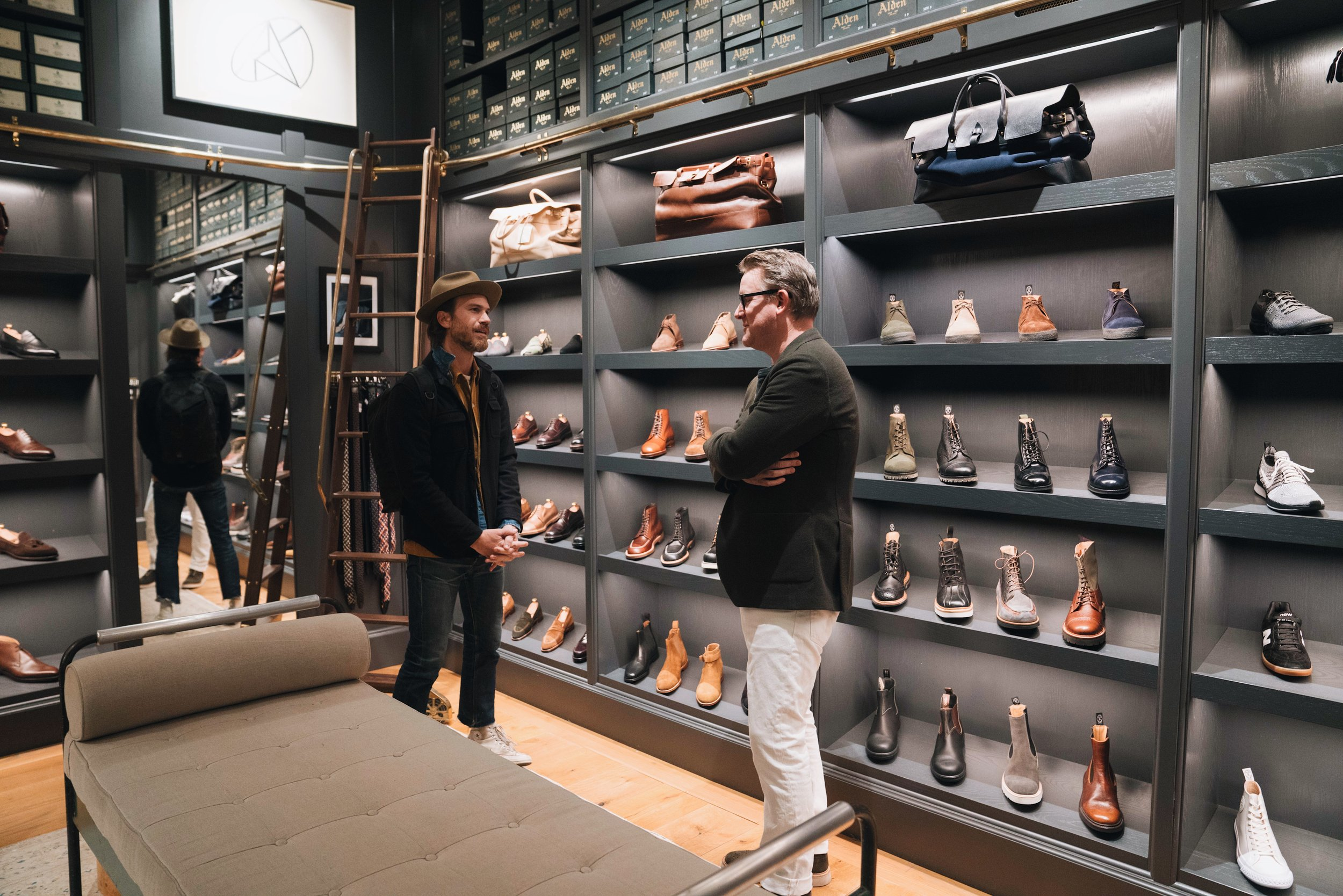 Todd talking to his colleague inside the Todd Snyder flagship store in Madison Square Park