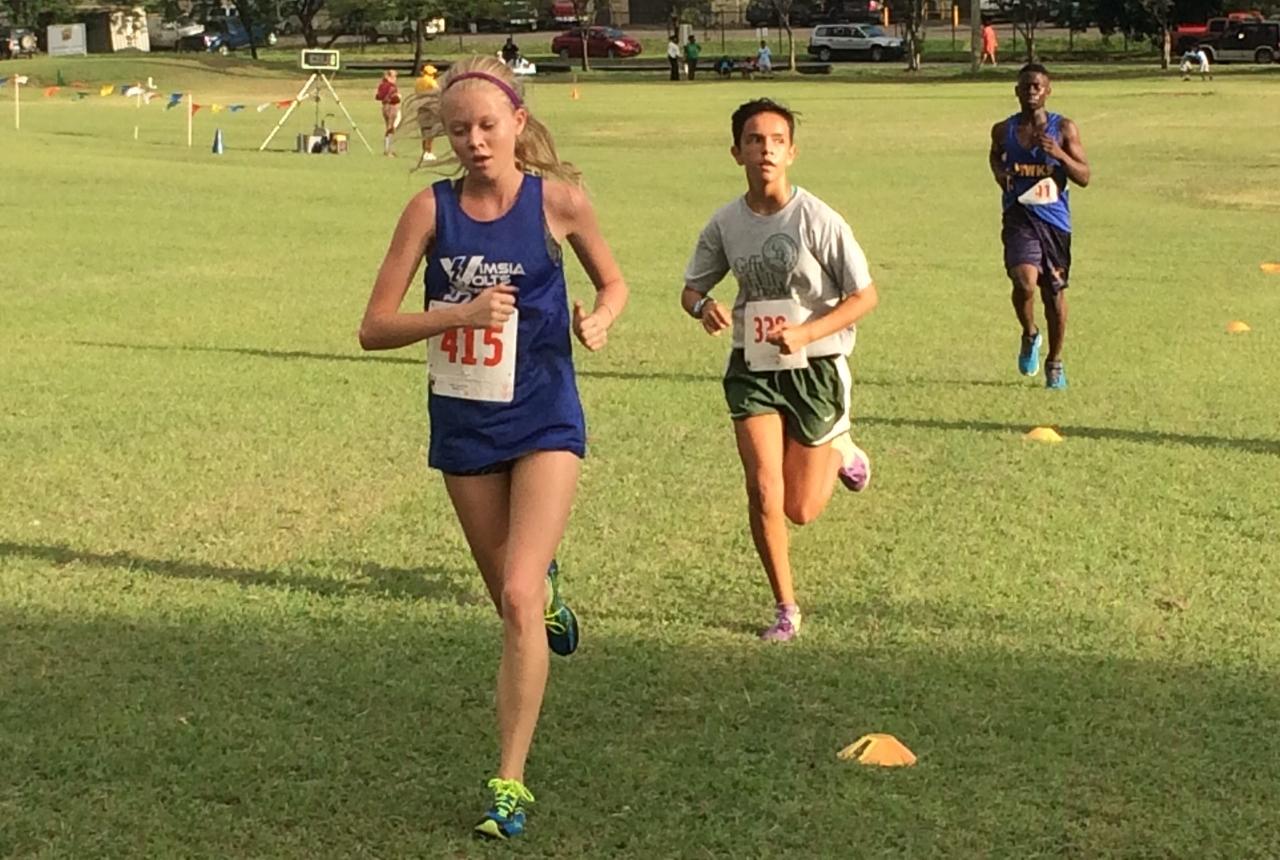 Varsity runner Talisse Thompson (#415)